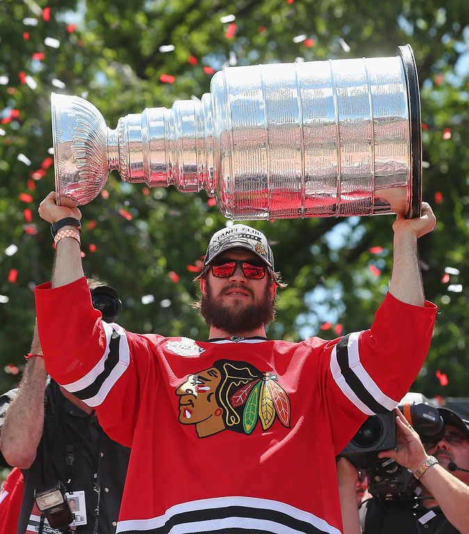 . Brent Seabrook #7 of the Chicago Blackhawks holds the Stanley Cup Trophy during the Blackhawks Victory Parade and Rally on June 28, 2013 in Chicago, Illinois.  (Photo by Jonathan Daniel/Getty Images)
