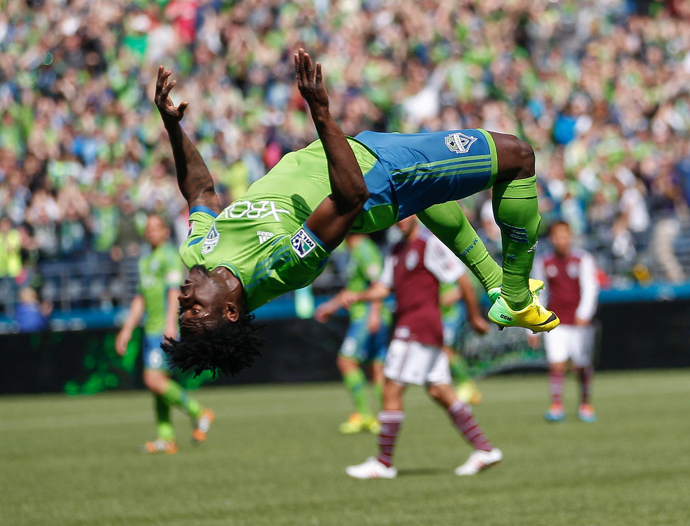 . Obafemi Martins #9 of the Seattle Sounders FC does a back flip after scoring a goal in the second half against the Colorado Rapids at CenturyLink Field on April 26, 2014 in Seattle, Washington. The Sounders defeated the Rapids 4-1. (Photo by Otto Greule Jr/Getty Images)