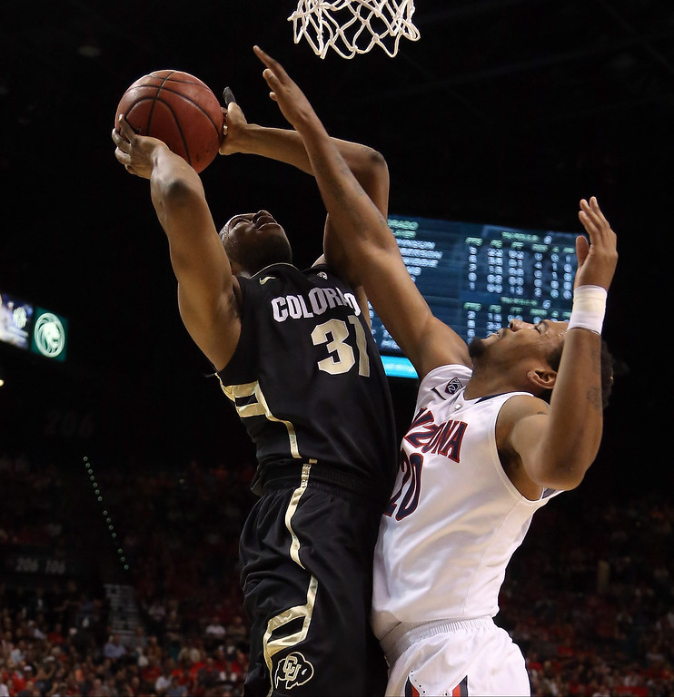 . Jeremy Adams #31 of the Colorado Buffaloes goes up for a shot against Jordin Mayes #20 of the Arizona Wildcats in the first half during the quarterfinals of the Pac-12 tournament at the MGM Grand Garden Arena on March 14, 2013 in Las Vegas, Nevada.  (Photo by Jeff Gross/Getty Images)