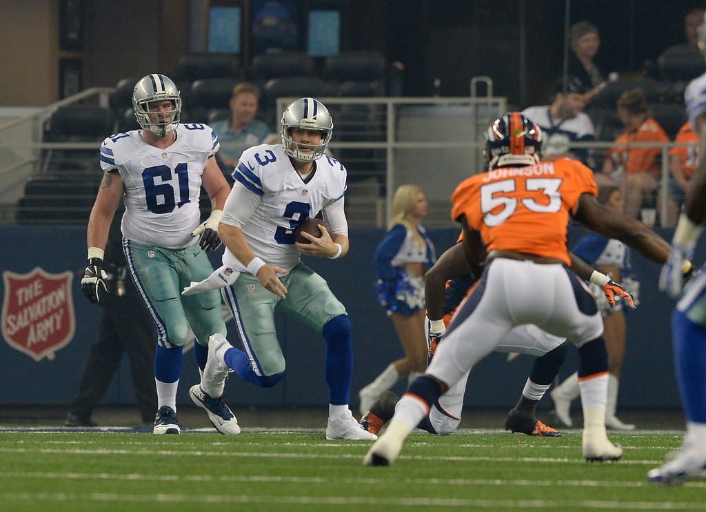. ARLINGTON, TX - AUGUST 28: Dallas Cowboys quarterback Brandon Weeden (3) scrambles out of the pocket against the Denver Broncos during the first quarter August 28, 2014 at AT&T Stadium. (Photo by John Leyba/The Denver Post)