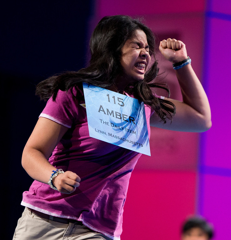 """. Amber Born, 14 of Marblehead, Mass. reacts after spelling the word \""""malacophilous\"""" correctly during the semifinal round of the National Spelling Bee, Thursday, May 30, 2013, in Oxon Hill, Md. (AP Photo/Evan Vucci)"""