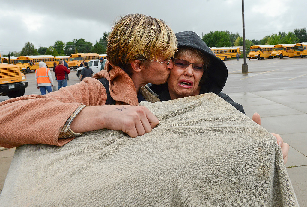 . Janice Wheeler cries as she greets her son Nathan Wheeler at LifeBridge Church Friday morning Sept. 13, 2013 after Nathan was evacuated from Lyons. (Lewis Geyer/Times-Call)