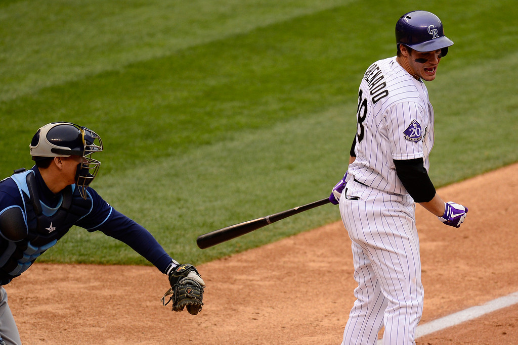 . DENVER, CO - MAY 5: Nolan Arenado (28) of the Colorado Rockies reacts to striking out to make the final out o the game as Jeremy Hellickson (58) of the Tampa Bay Rays applies the tag during the Rockies\' 8-3 loss.   (Photo by AAron Ontiveroz/The Denver Post)