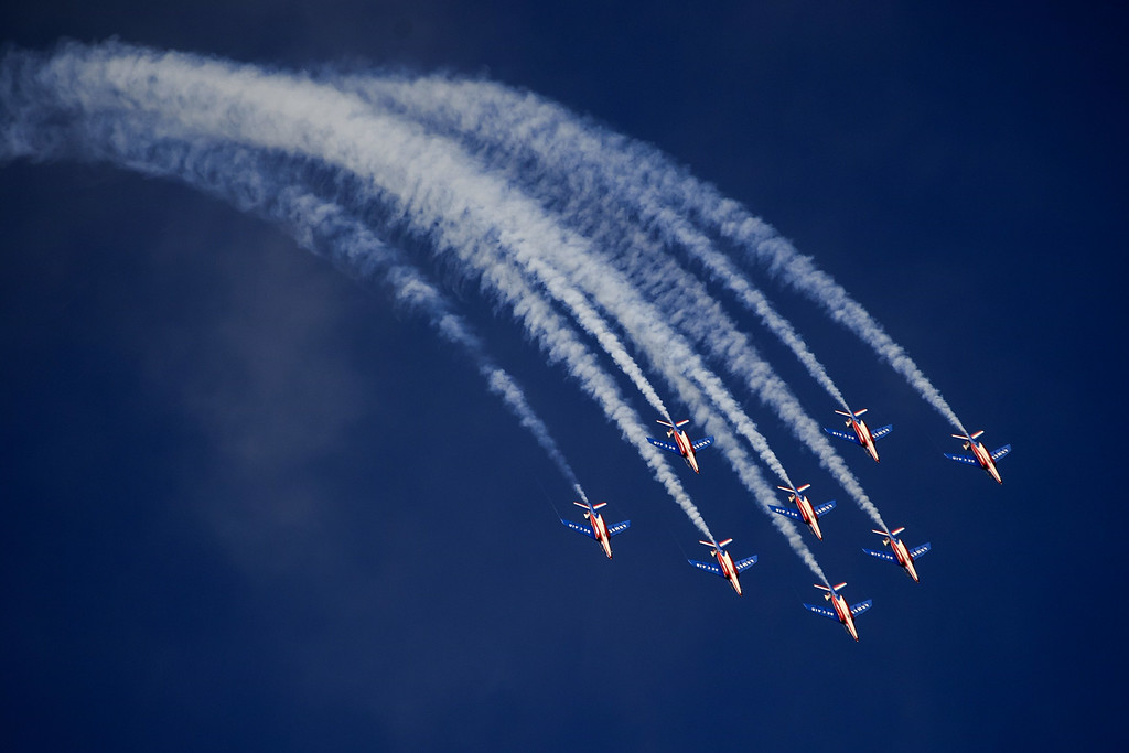 """. Jets of the \""""The Patrouille de France\"""" perform during the first day of AIR14 air show on August 30, 2014 in Payerne, western Switzerland.  AFP PHOTO / FABRICE COFFRINI/AFP/Getty Images"""
