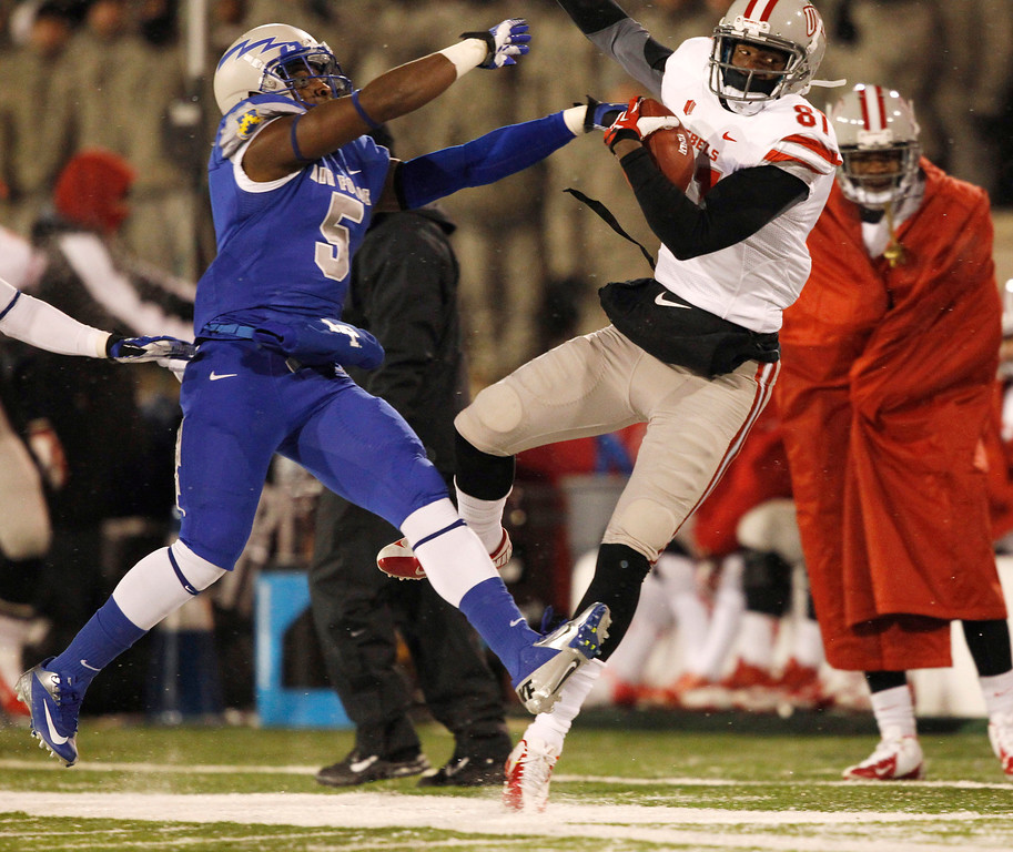 . UNLV wide receiver Devante Davis, right, goes out of bounds after pulling in a pass in front of Air Force strong safety Dexter Walker in the first quarter of an NCAA football game at Air Force Academy, Colo., on Thursday, Nov. 21, 2013. (AP Photo/David Zalubowski)