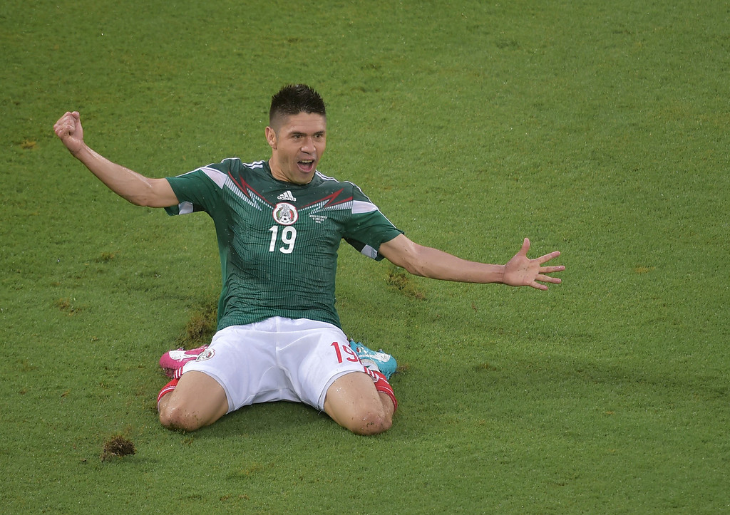 . Mexico\'s forward Oribe Peralta celebrates after scoring a goal during the Group A football match between Mexico and Cameroon at the Dunas Arena in Natal during the 2014 FIFA World Cup on June 13, 2014. GABRIEL BOUYS/AFP/Getty Images
