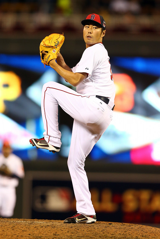 . American League All-Star Koji Uehara #19 of the Boston Red Sox pitches against the National League All-Stars in the sixth inning during the 85th MLB All-Star Game at Target Field on July 15, 2014 in Minneapolis, Minnesota.  (Photo by Elsa/Getty Images)