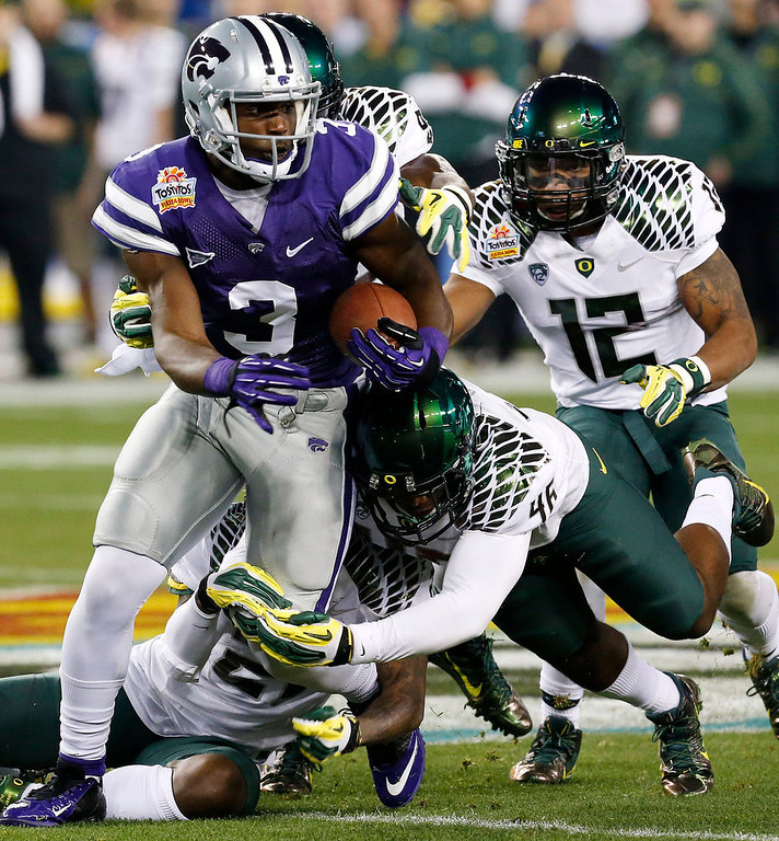 . Kansas State wide receiver Chris Harper (3) is tackled by Oregon linebacker Michael Clay (46) during the first half of the Fiesta Bowl NCAA college football game, Thursday, Jan. 3, 2013, in Glendale, Ariz. (AP Photo/Ross D. Franklin)