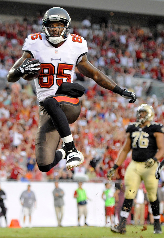 . Tampa Bay Buccaneers wide receiver Kevin Ogletree (85) celebrates after scoring a touchdown against the New Orleans Saints during the first quarter of an NFL football game on Sunday, Sept. 15, 2013, in Tampa, Fla. (AP Photo/Brian Blanco)
