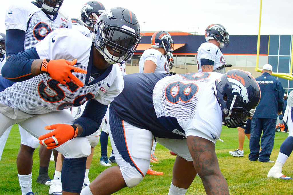 . Denver Broncos outside linebacker Von Miller (58) hams it up for the camera during drills on day seven of the Denver Broncos 2014 training camp July 31, 2014 at Dove Valley. (Photo by John Leyba/The Denver Post)