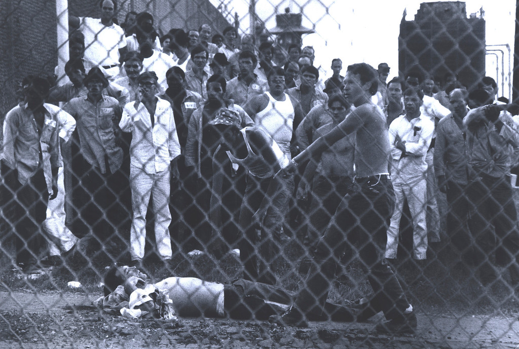 . This July 1973 photo provided by the Oklahoma Department of Corrections shows inmate behind a fence at the Oklahoma State Penitentiary at McAlester in McAlester, Okla. during one of the most destructive prison riots in American history. (AP Photo/Oklahoma Department of Corrections)