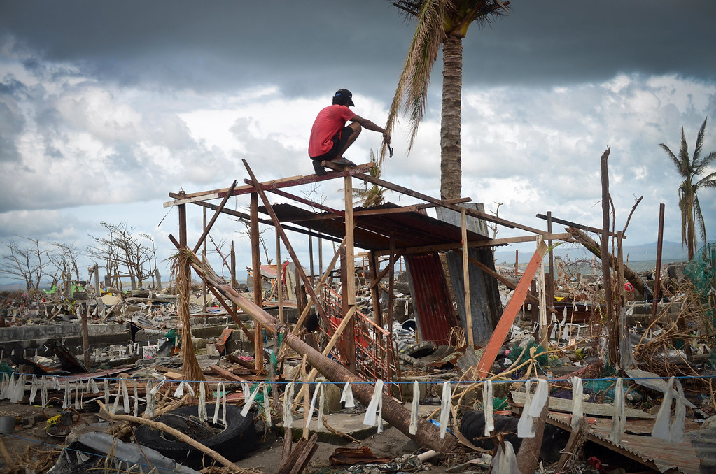 . A man tries to rebuild his shanty near the shoreline following the recent super typhoon on November 21, 2013 in Tacloban, Leyte, Philippines.  (Photo by Dondi Tawatao/Getty Images)
