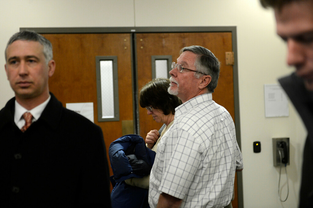 . Aurora theater shooting suspect James Holmes\' parents Arlene and Robert Holmes leave the courtroom after the  proceedings for their son during his arraignment Tuesday March 12, 2013. District Court Judge William Sylvester entered a Not Guilty plea on behalf of Holmes. The trial begins August 5, 2013. (Photo By Joe Amon/The Denver Post)