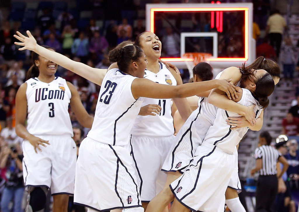 . Kaleena Mosqueda-Lewis #23 of the Connecticut Huskies celebrates with teammates after defeating the Louisville Cardinals during the 2013 NCAA Women\'s Final Four Championship at New Orleans Arena on April 9, 2013 in New Orleans, Louisiana.  (Photo by Chris Graythen/Getty Images)