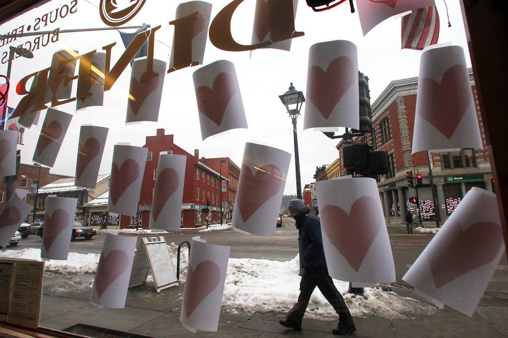 """. Paper hearts hang on a window on Valentine\'s Day on Thursday, Feb. 14, 2013 in Montpelier, Vt. The annual tradition of plastering Montpelier\'s downtown with valentine hearts has happened again.  A person  who is called the \""""Valentine\'s Phantom\"""" has been putting up the hearts for over 10 years.  (AP Photo/Toby Talbot)"""