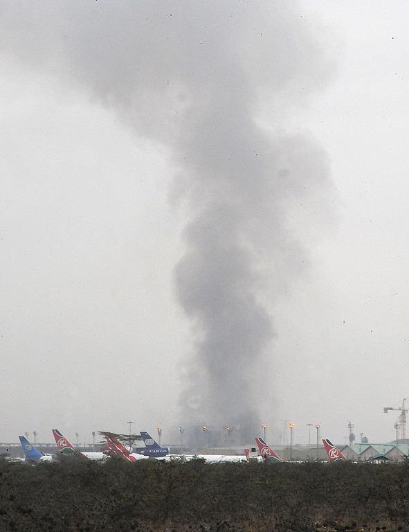 . Aircrafts are parked as smoke billows from a terminal of Jomo Kenyatta International Airport in Nairobi on August 7, 2013. A massive fire shut down Nairobi\'s international airport today with flights diverted to regional cities as firefighters battled to put out the blaze in east Africa\'s biggest transport hub.  AFP PHOTO / SIMON MAINA/AFP/Getty Images