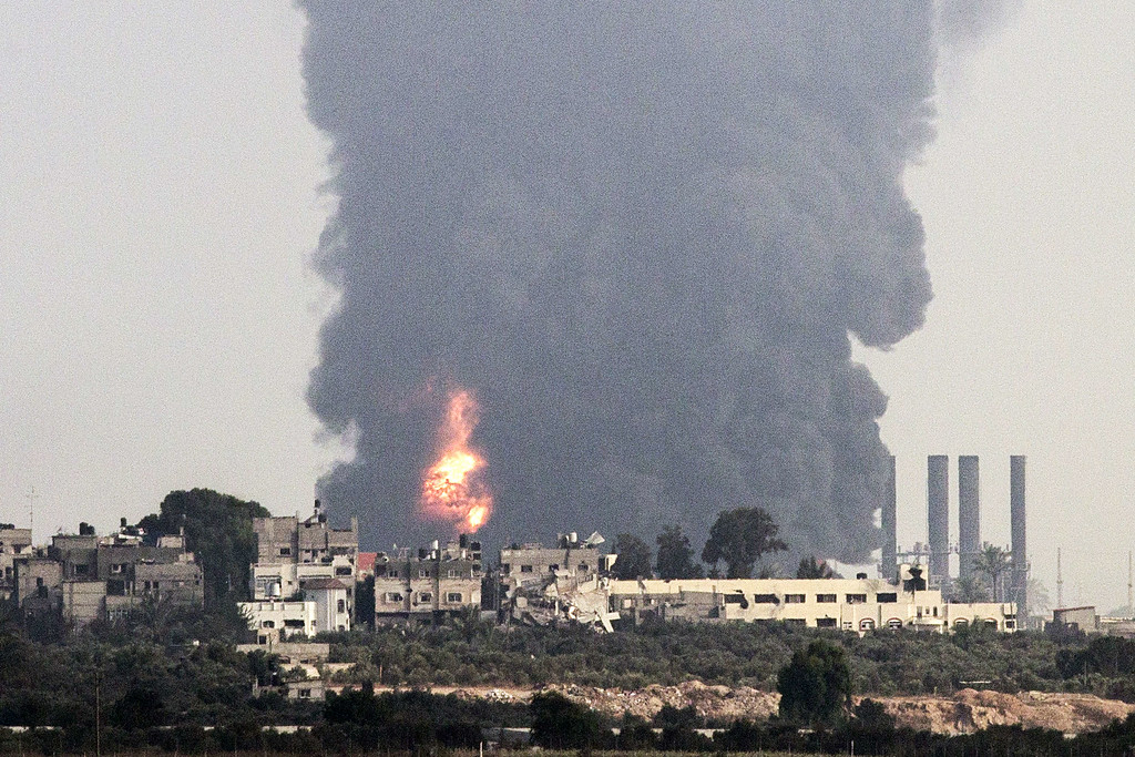 . A picture taken from the southern Israeli Gaza border shows smoke billowing from a power plant in the coastal Palestinian enclave following an Israeli air strike on July 29, 2014.  AFP PHOTO / JACK GUEZ/AFP/Getty Images