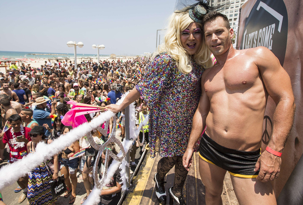 . Israeli drag queens and go-go dancers dance on a truck during the annual gay pride parade in the Israeli coastal city of Tel Aviv on June 13, 2014. AFP PHOTO/JACK GUEZ/AFP/Getty Images