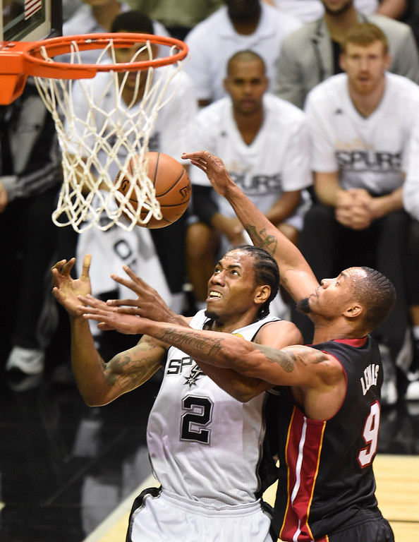 . Rashard Lewis of the Miami Heat (R) fouls Kawhi Leonard of the San Antonio Spurs under the Spurs basket during Game 2 of the NBA Finals on June 8, 2014 in San Antonio,Texas.  ROBYN BECK/AFP/Getty Images