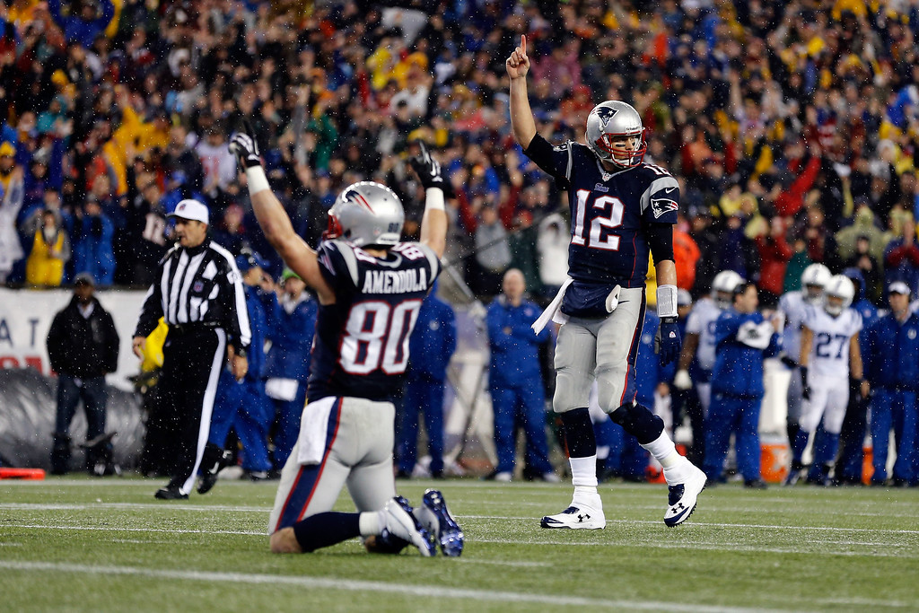 . FOXBORO, MA - JANUARY 11:   Tom Brady #12 and Danny Amendola #80 of the New England Patriots celebrate after a play against the Indianapolis Colts during the AFC Divisional Playoff game at Gillette Stadium on January 11, 2014 in Foxboro, Massachusetts.  (Photo by Jim Rogash/Getty Images)