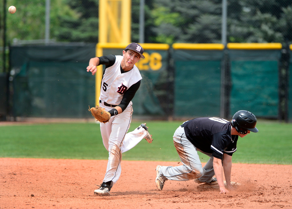 . LAKEWOOD, CO - MAY 23: Durango\'s Jeremy Szura gets Anthony Martinez out at second base. The Durango Demons take on the Green Mountain Rams in the 4A Baseball State Semi-Final Championships. (Kathryn Scott Osler, The Denver Post)