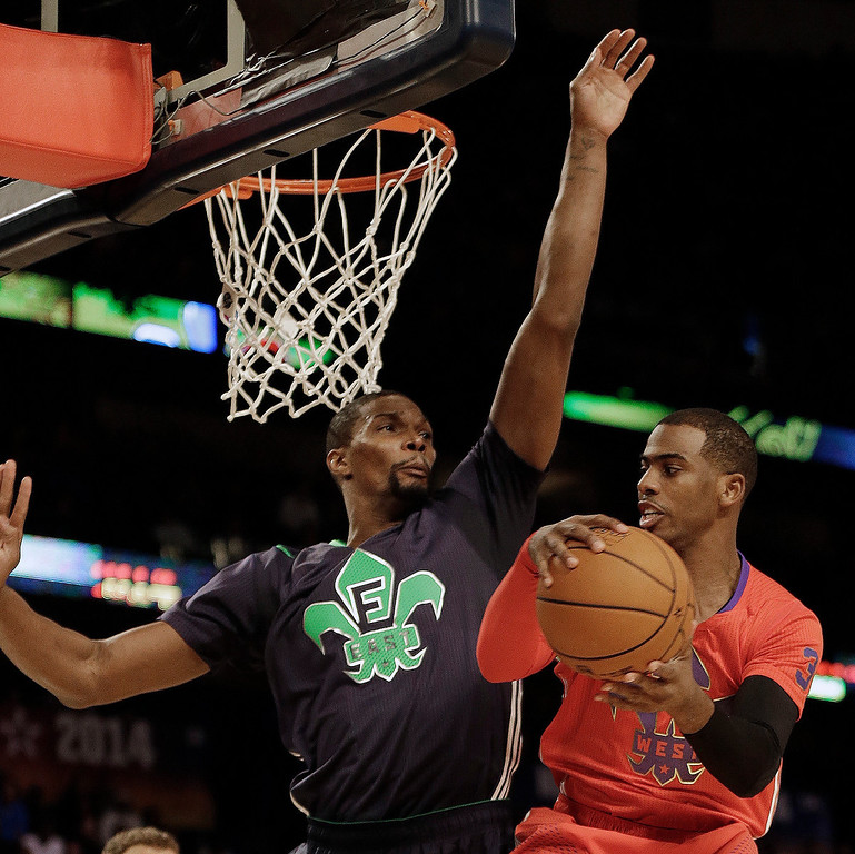 . West Team\'s Chris Paul, of the Los Angeles Clippers (3) heads to the hoop as East Team\'s Chris Bosh, of the Miami Heat (1) defends during the NBA All Star basketball game, Sunday, Feb. 16, 2014, in New Orleans. (AP Photo/Gerald Herbert)