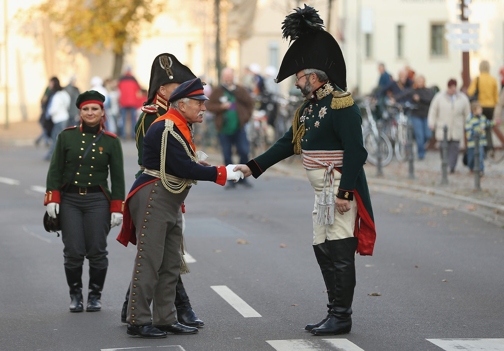 . An actor in the role of Prussian Field Marshall Gebhard Leberecht von Bluecher (L) greets another in the role of a Russian general in Liebertwolkwitz district, where historical enthusiasts have recreated an 1813 village, during events to commemorate the 200th anniversary of The Battle of Nations on October 16, 2013 in Leipzig, Germany.  (Photo by Sean Gallup/Getty Images)