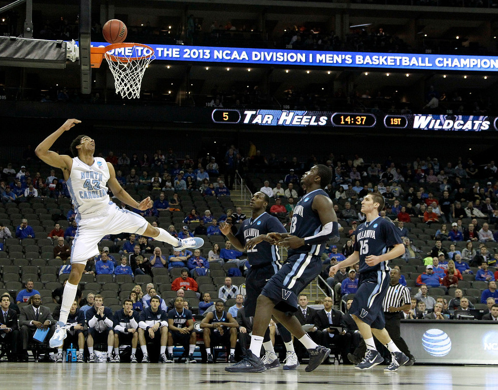 . North Carolina forward James Michael McAdoo (43) puts up a shot during the first half of a second-round game against Villanova in the NCAA college basketball tournament Friday, March 22, 2013, in Kansas City, Mo. (AP Photo/Charlie Riedel)