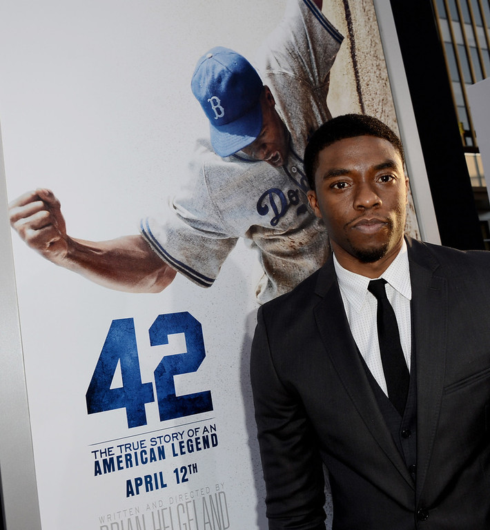 ". Actor Chadwick Boseman arrives at the premiere of Warner Bros. Pictures\' and Legendary Pictures\' ""42\"" at the Chinese Theatre on April 9, 2013 in Los Angeles, California.  (Photo by Kevin Winter/Getty Images)"