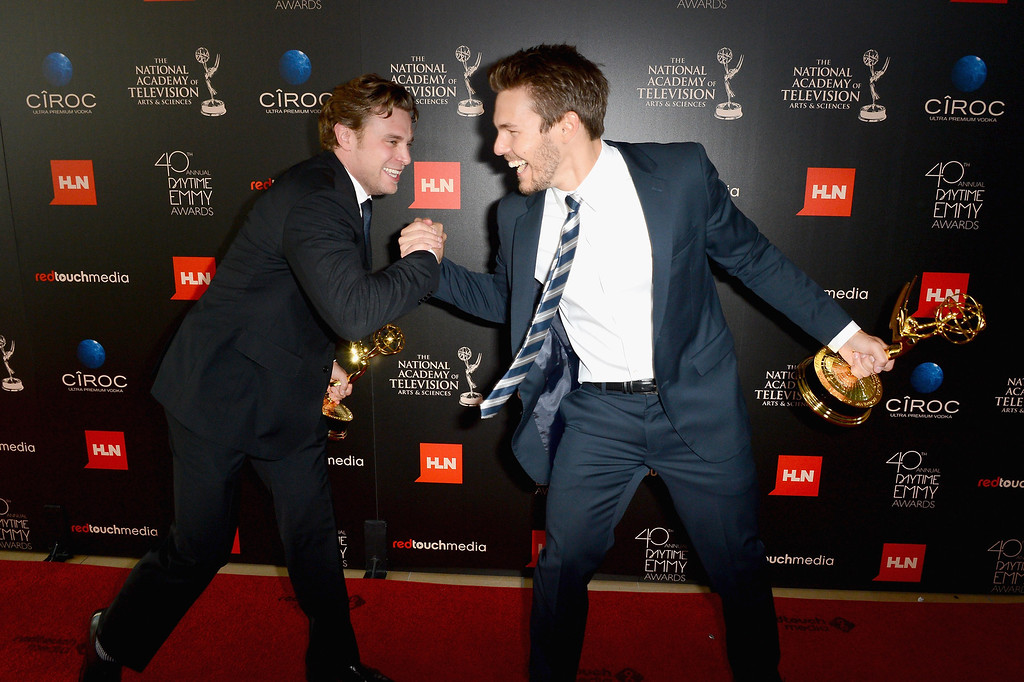 ". Actors Billy Miller (L) and Scott Clifton pose with the Outstanding Supporting Actor in a Drama Series award for ""The Young and the Restless\"" and \""The Bold and the Beautiful\"" in the press room during The 40th Annual Daytime Emmy Awards at The Beverly Hilton Hotel on June 16, 2013 in Beverly Hills, California.  (Photo by Mark Davis/Getty Images)"