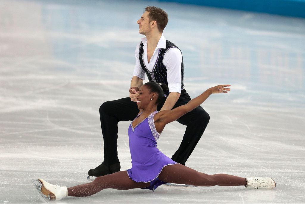 Description of . Vanessa James and Morgan Cipres of France compete in the pairs short program figure skating competition at the Iceberg Skating Palace during the 2014 Winter Olympics, Tuesday, Feb. 11, 2014, in Sochi, Russia. (AP Photo/Ivan Sekretarev)
