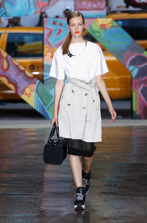 . A model walks the runway at the DKNY Women\'s  Spring 2014 fashion show at Mercedes-Benz Fashion Week Spring 2014 - Official Coverage - Best Of Runway Day 4 on September 8, 2013 in New York City.  (Photo by Peter Michael Dills/Getty Images for Mercedes-Benz)