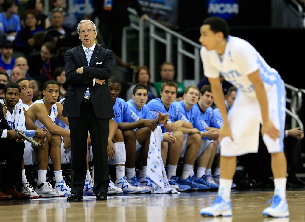 . KANSAS CITY, MO - MARCH 22:  Head coach Roy Williams of the North Carolina Tar Heels watches play as Marcus Paige #5 stands on the court in the first half against the Villanova Wildcats during the second round of the 2013 NCAA Men\'s Basketball Tournament at the Sprint Center on March 22, 2013 in Kansas City, Missouri.  (Photo by Jamie Squire/Getty Images)
