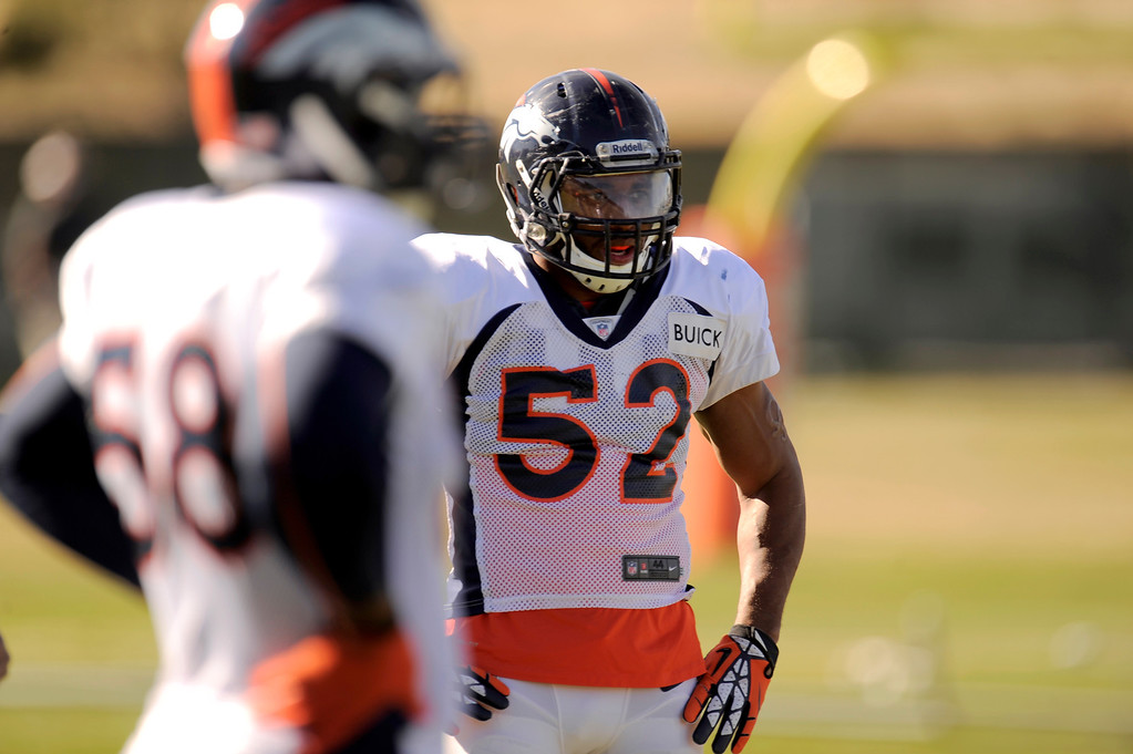 . Denver Broncos outside linebacker Wesley Woodyard (52) looks on during drills at practice November 13, 2013 at Dove Valley (Photo by John Leyba/The Denver Post)