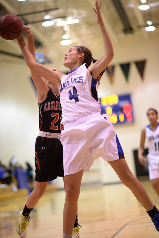 . AURORA, CO. JANUARY 08: Hannah Hasstedt of Grandview High School (4) controls the rebound in the 2nd half of the game against Eaglecrest High School at Grandview High School in Aurora, Colorado January 8, 2014. Grandview won 69-22. (Photo by Hyoung Chang/The Denver Post)