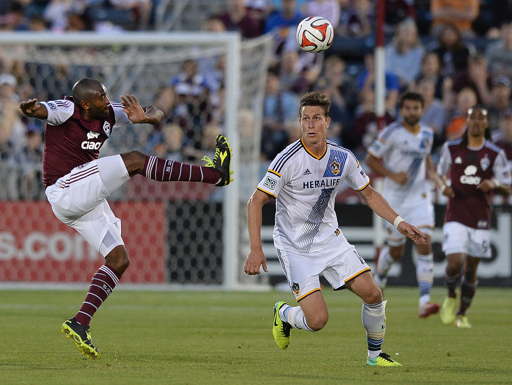 . COMMERCE CITY, CO - MAY 3:  Colorado defender Marvell Wynne (22) kicked the ball past Los Angeles forward Rob Friend (16)  in the first half. The Colorado Rapids defeated the Los Angeles Galaxy 1-0 Saturday night, May 3, 2014 at Dick\'s Sporting Good Park. (Photo by Karl Gehring/The Denver Post)