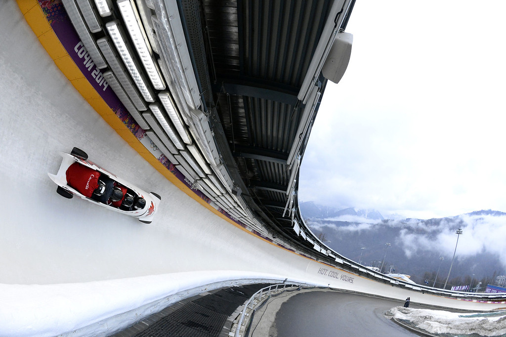 . Canada-2 four-man bobsleigh, steered by Lyndon Rush, takes part in a training session at the Sanki Sliding Center in Rosa Khutor during the Sochi Winter Olympics on February 21, 2014. LIONEL BONAVENTURE/AFP/Getty Images
