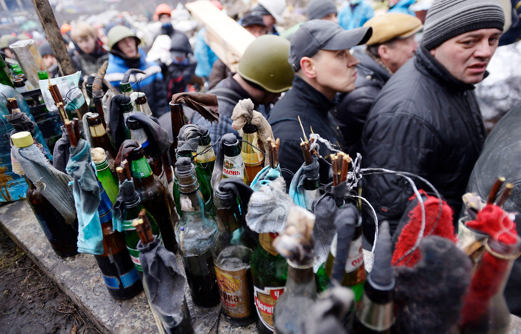 . Molotov cocktails are seen at the protesters\' barricade in Kiev, Ukraine, 20 February 2014. More than 60 people have been killed in street fighting in Kiev on Thursday, the nationalist Svoboda opposition party says. EPA/LASZLO BELICZAY