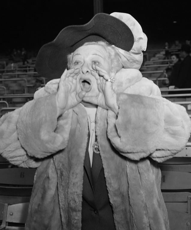 . An early arrival, and an ardent fan was singer Sophie Tucker as she whooped and yelled at the third game of the World Series at the Yankee Stadium in New York on Oct. 4, 1952. (AP Photo/Dan Grossi)