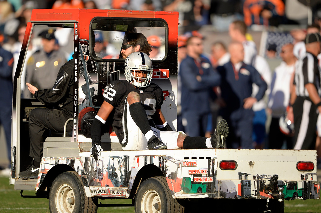 . Defensive back Taiwan Jones (22) of the Oakland Raiders is carted off the field at O.co Coliseum December 29, 2013 Oakland, Calif. (Photo By Joe Amon/The Denver Post)