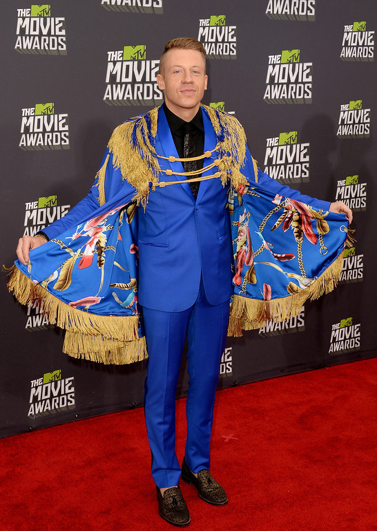 . Recording artist Macklemore arrives at the 2013 MTV Movie Awards at Sony Pictures Studios on April 14, 2013 in Culver City, California.  (Photo by Jason Merritt/Getty Images)
