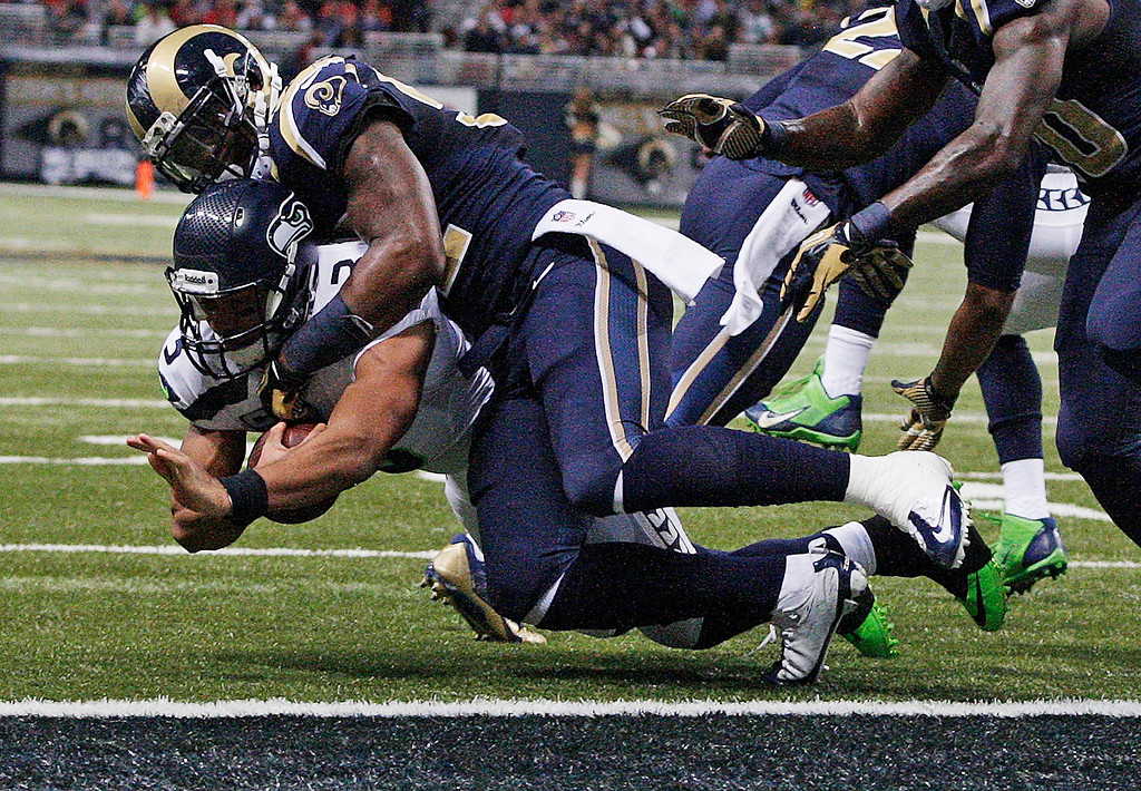 . St. Louis Rams outside linebacker Alec Ogletree (52) stops Seattle Seahawks quarterback Russell Wilson (3) near the goal line during the first half of an NFL football game, Monday, Oct. 28, 2013, in St. Louis. (AP Photo/Tom Gannam)