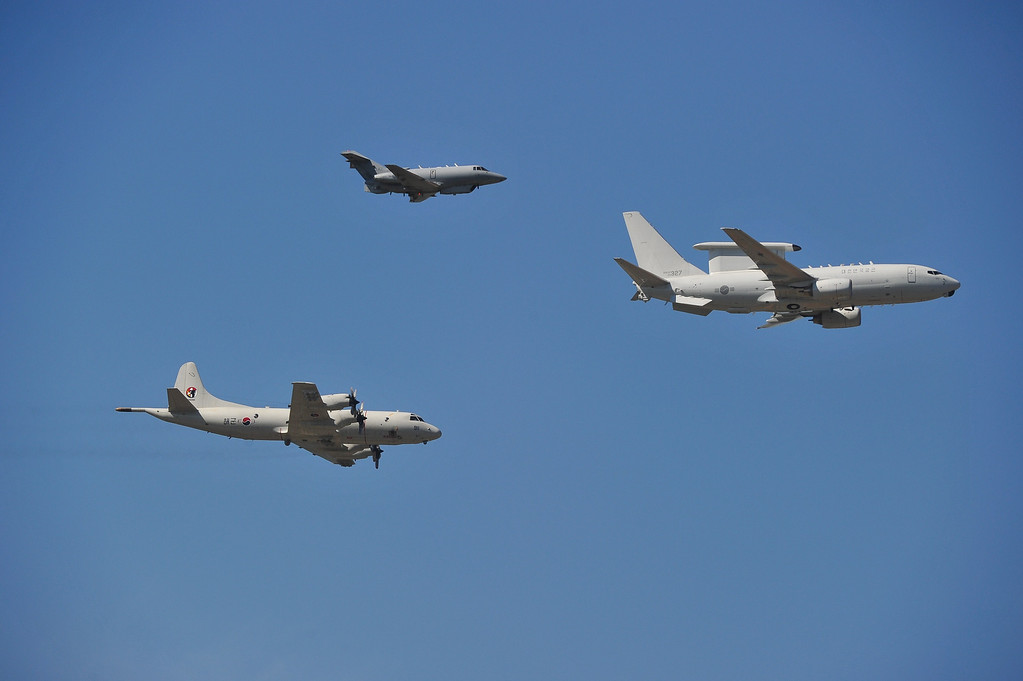 . Military aircrafts, a RC-800 (top), a P-3C Orian (L) and a E-737 Peace Eye of South Korean armed forces fly over Seoul Air Base during the 65th anniversary of the Republic of Korea armed Forces day on September 27, 2013.  This year\'s event opened with the largest scale of military with eleven thousand of troops, some 190 armed vehicles and about 120 military aircrafts.    KIM DOO-HO/AFP/Getty Images