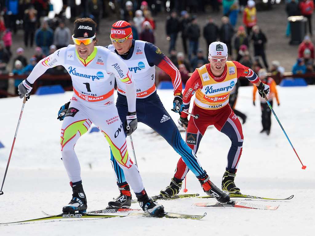. Canada\'s Alex Harvey (L), Russia\'s Alexander Lekov (C) and Norway\'s Martin Johnsrud Sundby (R) in action during the Men\'s 15 km pursuit race at the FIS Cross Country World Cup in Falun, Sweden, 16 March 2014.  EPA/ANDERS WIKLUND