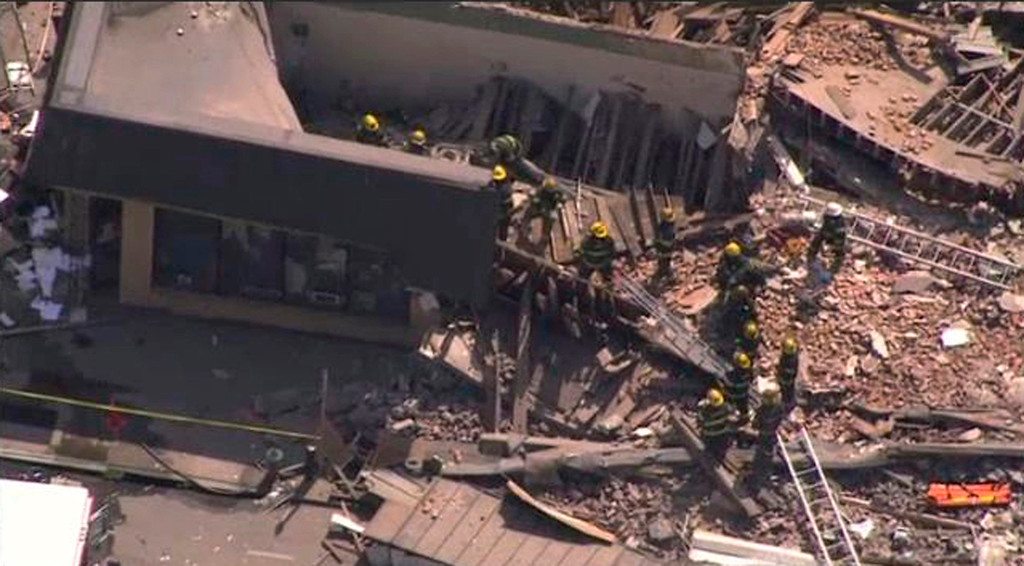 . Rescue workers search through rubble following a building collapse as seen in this aerial still image taken from video courtesy of NBC10.com, in Philadelphia June 5, 2013. An industrial building collapsed in downtown Philadelphia on Wednesday and rescue workers rushed to the scene to investigate the damage and determine whether there were any victims, police said. REUTERS/NBC10.com/Handout via Reuters