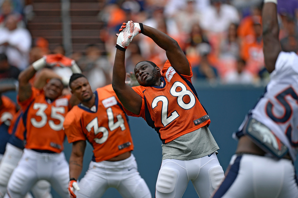 . Denver Broncos running back Montee Ball (28) stretches on day four of the Denver Broncos 2014 training camp July 27, 2014 at Sports Authority Field at Mile High. (Photo by John Leyba/The Denver Post)