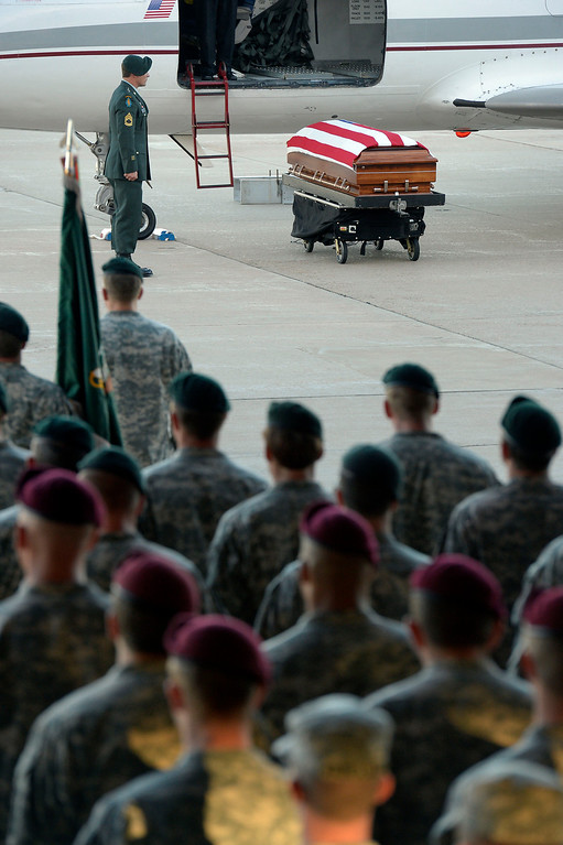. Green Beret and Airborne stand at attention as military officials brought home sergeant Liam Nevins, 32, from Dover AFB September 30, 2013 to Buckley AFB. Nevins, of Denver, was killed two weekends ago in Afghanistan. (Photo by John Leyba/The Denver Post)