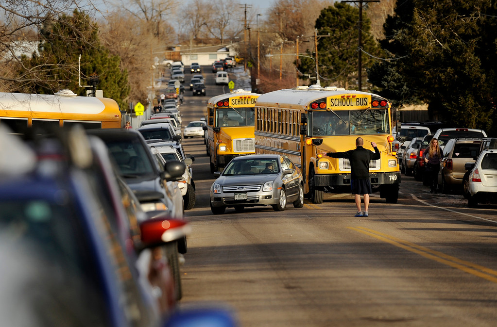 . Arapahoe High School (AHS) students were transferred on Dec. 13 to Euclid Middle School (EMS) in Littleton, Colo., after a lone gunman - a senior at AHS - entered the high school and fired gunshots, wounding three people and then killing himself. Both AHS students and EMS students are being released one-by-one to parents and guardians in order to ensure that all students are accounted for. Photo by Jamie Cotten, Special to The Denver Post