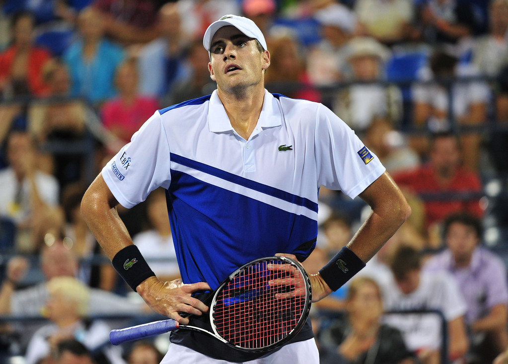 . John Isner of the US reacts to a shot to Gael Monfils of France during their 2013 US Open men\'s singles match at the USTA Billie Jean King National Tennis Center August 29, 2013 in New York. STAN HONDA/AFP/Getty Images