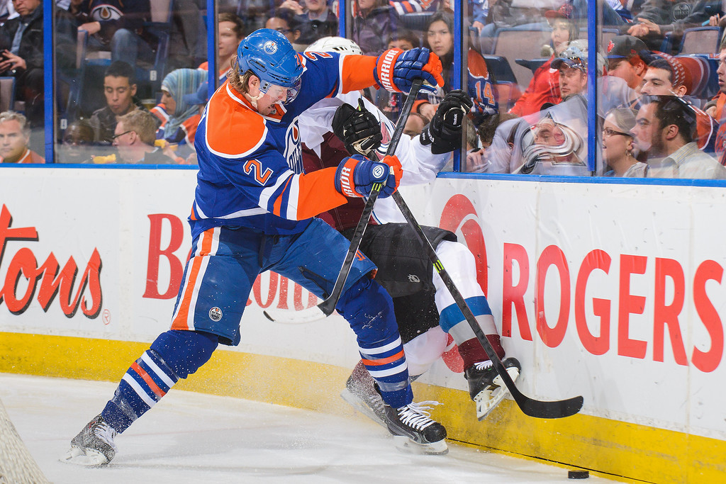 . Jeff Petry #2 of the Edmonton Oilers checks Erik Johnson #6 of the Colorado Avalanche during an NHL game at Rexall Place on April 8, 2014 in Edmonton, Alberta, Canada. (Photo by Derek Leung/Getty Images)